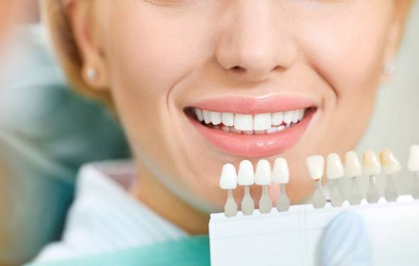 white teeth and shade guide